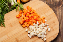 Chopped vegetables on a cutting board Royalty Free Stock Image