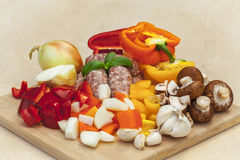 Chopped vegetables and sausages. Royalty Free Stock Photos