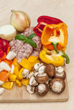 Chopped vegetables and sausages. Royalty Free Stock Photography