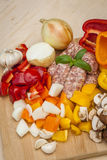 Chopped vegetables and sausages. Stock Photo
