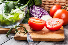 Chopped vegetables: tomatoes on cutting board Stock Photography