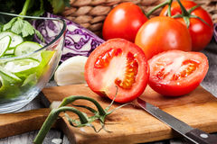 Chopped vegetables: tomatoes on cutting board Stock Photos