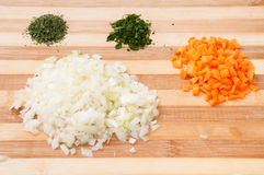 Chopped vegetables on the wooden board Royalty Free Stock Photos