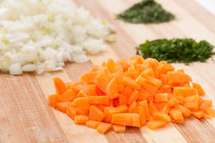 Chopped vegetables on the wooden board Royalty Free Stock Image