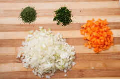 Chopped vegetables on the wooden board Stock Image