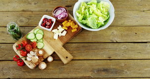 Chopped vegetables on wooden table stock video