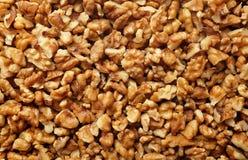 Chopped walnut background Royalty Free Stock Images
