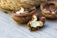 Chopped walnut on wood background texture Royalty Free Stock Image