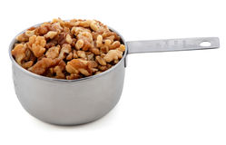 Chopped walnuts presented in an American metal cup measure Stock Photo