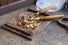Chopped walnuts on a wooden board Stock Image