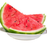 Chopped watermelon on a plate. On a white background royalty free stock photography
