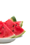 Chopped watermelon on a plate. On a white background stock image