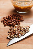 Chopped and whole hazelnuts Royalty Free Stock Images