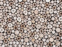 Chopped wood background. Background of neatly arranged pile of cross-cut wooden logs Stock Photos