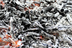 Chopped wood burns and smokes in the grill. Royalty Free Stock Photography