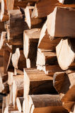Chopped wood. Fire wood arranged in a large stack Royalty Free Stock Photos