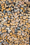 Chopped wood log stored as wall next to home for winter Stock Photography