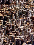 Chopped Wood & Logs. A background of chopped wood and tree trunks Royalty Free Stock Photography