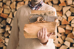 Chopped wood. Man holding pile of chopped wood Royalty Free Stock Photos