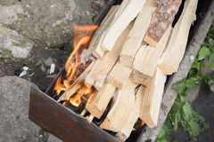 Chopped wood in mangal Stock Images