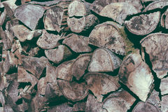 Chopped wood pile aged bark Royalty Free Stock Image
