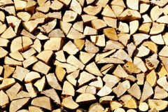 Chopped wood, stacked in a woodpile. Stock Photography