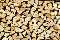 Chopped wood, stacked in a woodpile. Royalty Free Stock Photos