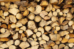 Chopped wood, stacked in a woodpile. Solid ecological fuel for heating the house in winter frost. Renewable energy Stock Photos