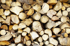 Chopped wood, stacked in a woodpile. Royalty Free Stock Images