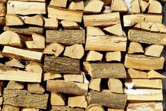 Chopped wood, stacked in a woodpile. Stock Images