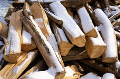 Chopped firewood unter the snow stock photo