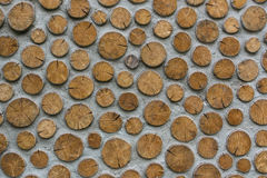 Chopped wood wall. Stacked chopped wood on the concrete wall background Royalty Free Stock Images