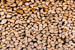 Chopped wooden logs stacked in woodpile Royalty Free Stock Photography