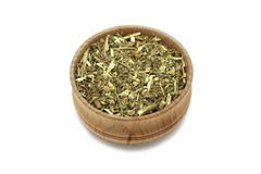 Chopped wormwood into in a wooden cup Stock Image