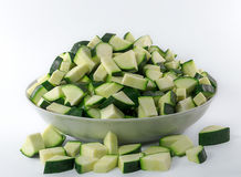 Chopped zucchini in a bowl  on white Stock Photos