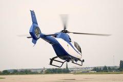 Chopper. A white-blue chopper is landing Stock Photo