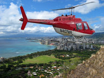 Chopper. Close fly by by chopper on hawaii diamond head royalty free stock photos