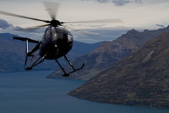 Chopper action over Queenstown Royalty Free Stock Image