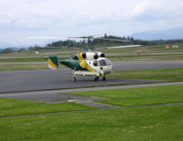 Chopper Landing. Helicopter waiting for take-off on a Victoria, BC airield Royalty Free Stock Photo