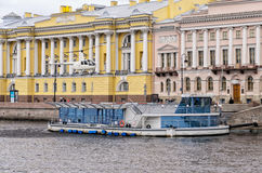 A chopper landing on the pier by the Senate and Sinod building at the Neva river. Stock Photography