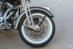 Chopper motorcycle forward tyre wheel. Retro style stock photography