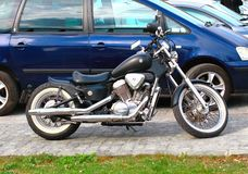 Chopper motorcycle. Parked outside in a parking lot royalty free stock photography