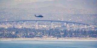Chopper in San Diego sky over Coronado Bridge royalty free stock photo