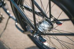 Chopper wheel. Custom chopper bicycle on street Royalty Free Stock Image