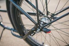 Chopper wheel. Custom chopper bicycle on street Royalty Free Stock Photography