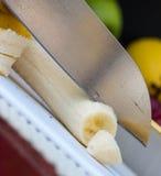 Chopping Banana Represents Bananas Exotic And Bannannas. Chopping Banana Showing Fruit Skin And Tropical stock images