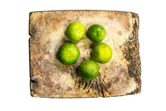 Chopping block Lemon. Lemon slice on chopping block Stock Images
