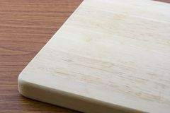 Chopping board. A wooden chopping board on a table top Royalty Free Stock Photography