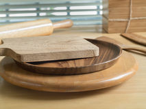 Chopping board and baking utensils Stock Images