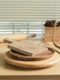Chopping board and baking utensils Stock Photography